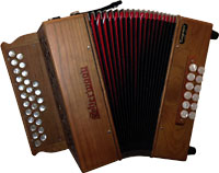 Sherwood Stowe II D/G Melodeon, Cagnoni Reeds 2 1/2 row model with 27 treble buttons. 2 voice. 12 bass buttons
